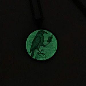 Glow in the dark raven necklace